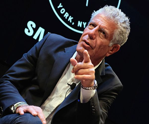 Anthony Bourdain sits onstage at an event.