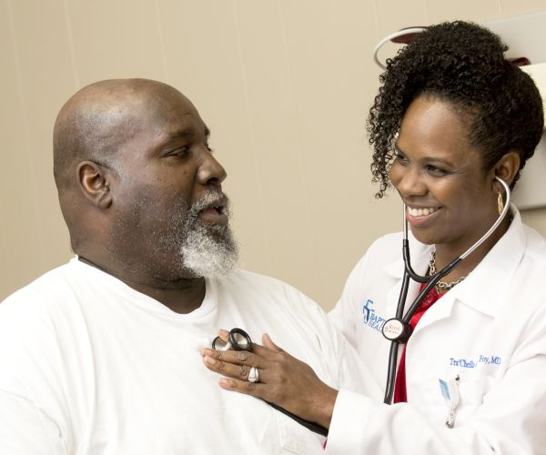 Tra'Chella Johnson Foy with patient