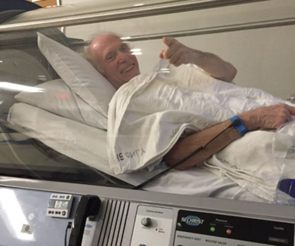 Patient giving a thumbs up in the hyperbaric chamber