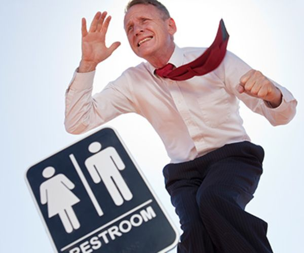 man running to the bathroom