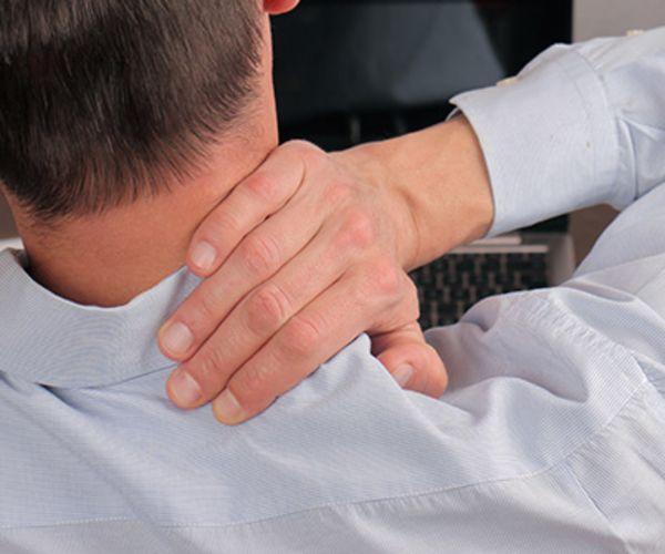 man massaging shoulder