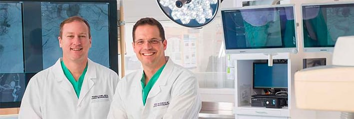 neurosurgeons smile in our Lyerly Neurosurgery operating room