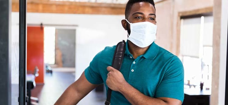employee wearing surgical mask