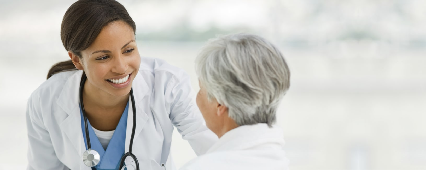 smiling female doctor talking with a female patient