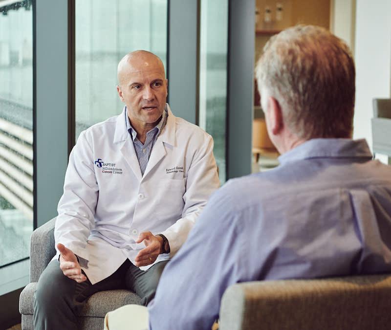 Dr. Gorak, hematologist oncologist, talks with a male patient.