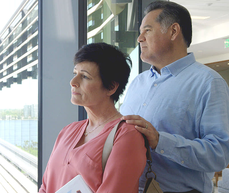 A patient and her husband look out the Baptist MD Anderson Cancer Center window to the St. John's River.