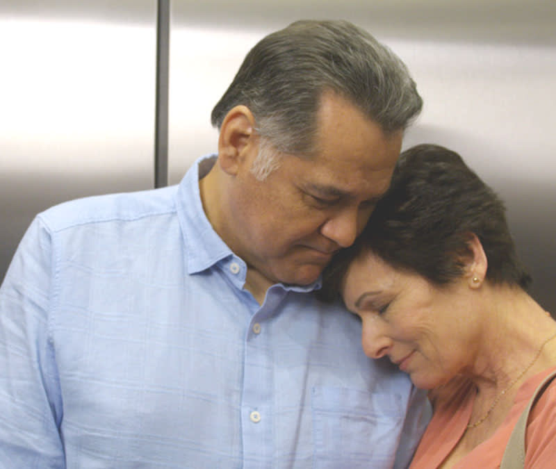 A female patient leans against her husband in the elevator on her way to her first Baptist MDAnderson appointment.