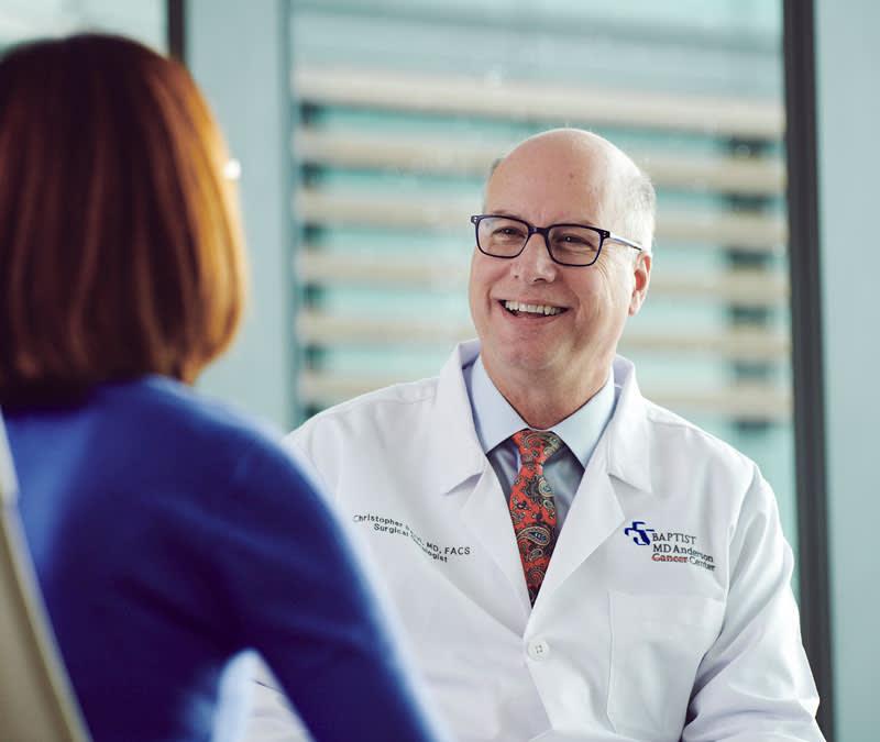 Dr. Pezzi smiles at a female patient.