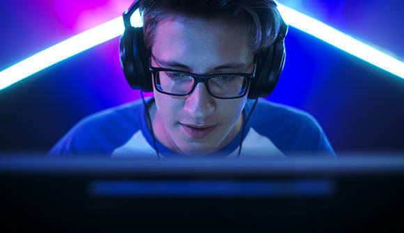 A young man plays video games.