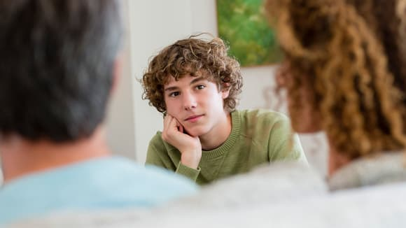 teen talking to his parents