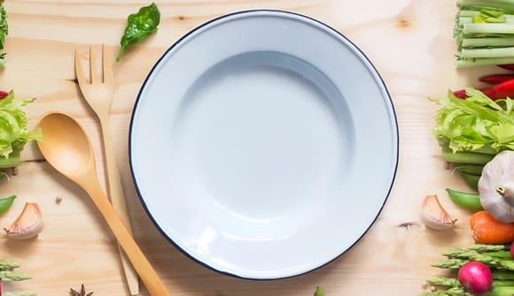 plate, spoon, fork and fresh vegetables