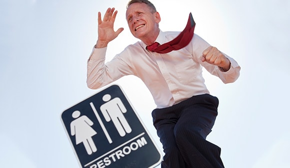 man running to the bathroom