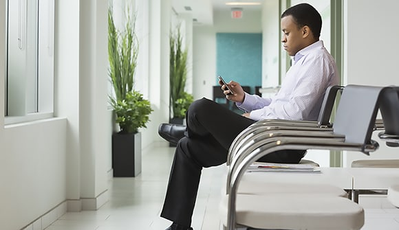 Sitting man in waiting room