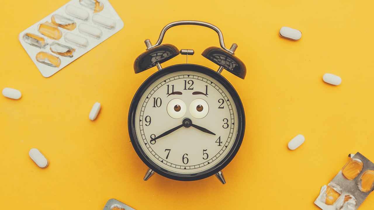 alarm clock and assorted pills