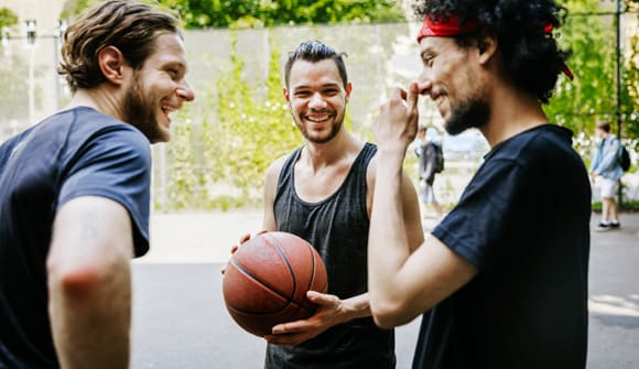 Men playing basketball