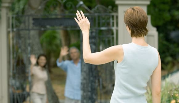 Neighbors waving from a distance