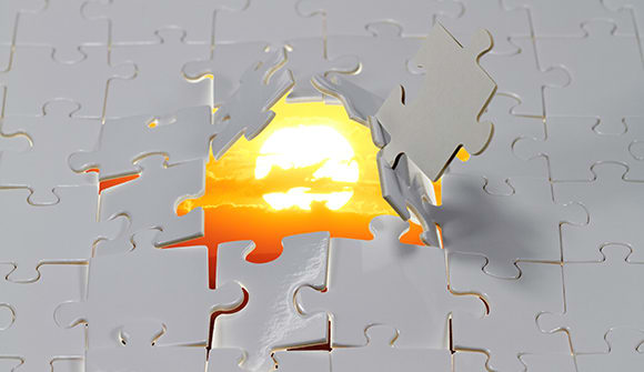 puzzle pieces with sunset