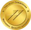 gold colored circle graphic Joint Commission National Quality Approval sea