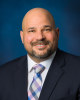 headshot photo of wellness coach Timothy Christopher
