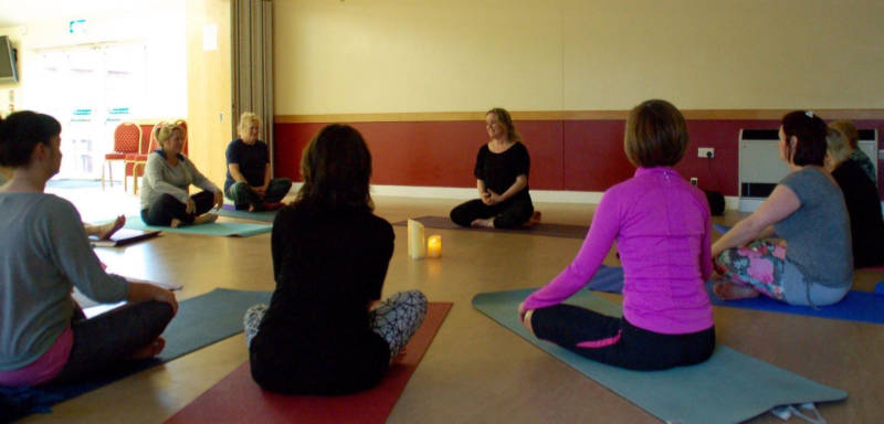 Yoga group sitting in circle