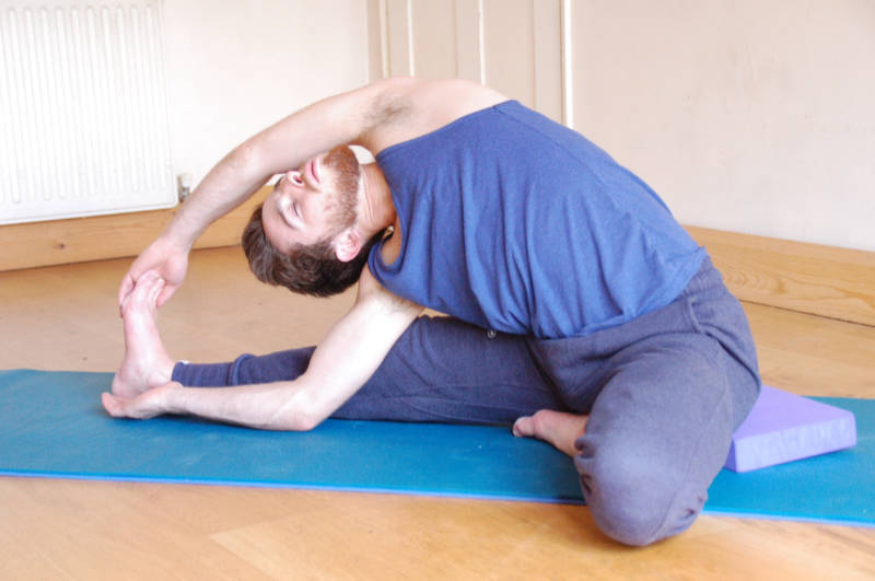 Man doing a sitted side bend