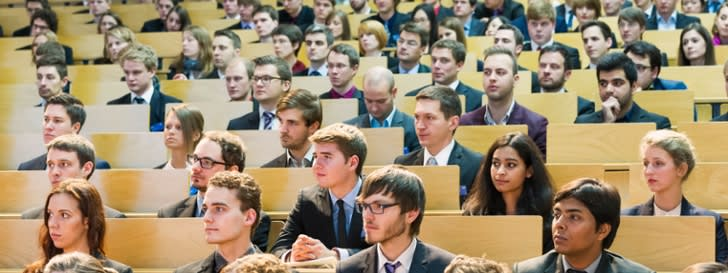 Picture shows a lecture hall with students