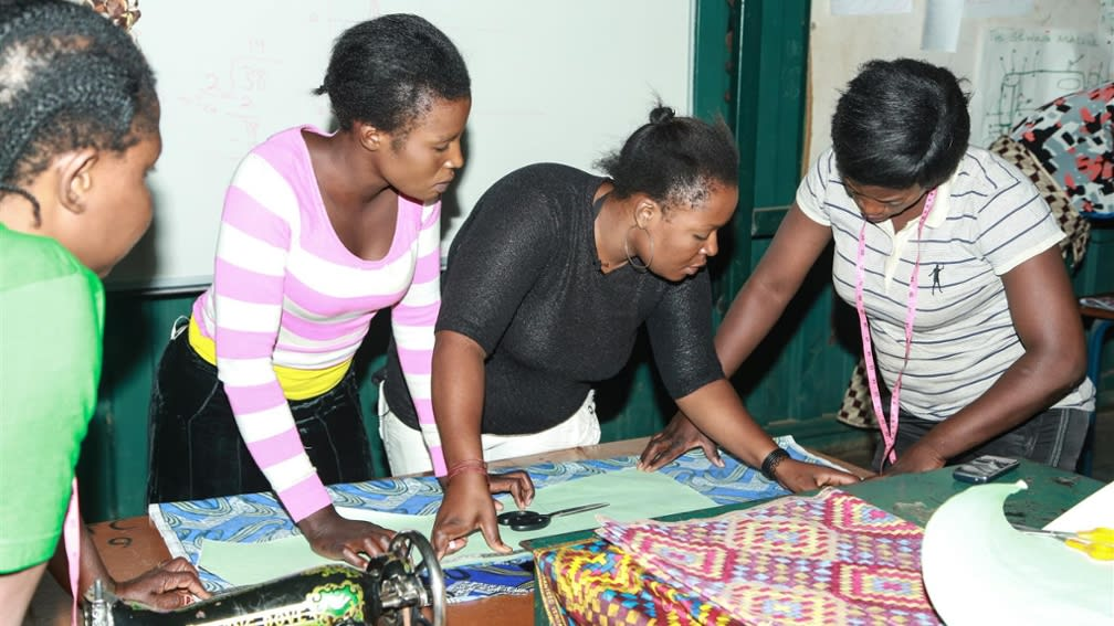 Young women receive a tailoring apprenticeship.