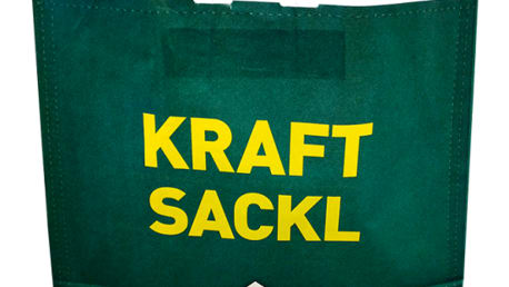 The picture shows a dark green bag with a yellow inscription.