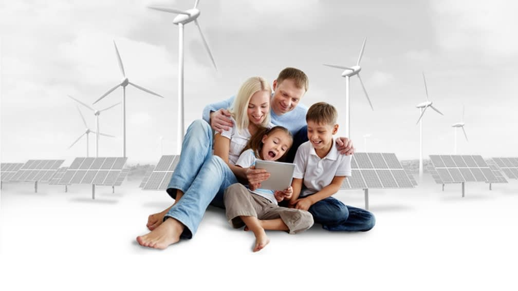 Family in front of a graphic with wind turbine and photovoltaics