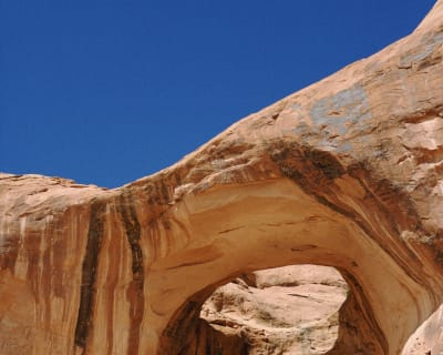 Looking up into one of the cavernous arches in Moab, UT, USA.