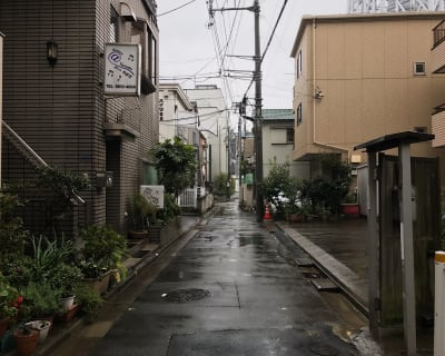 Looking down one of the many alleys in Tokyo after a light rain.