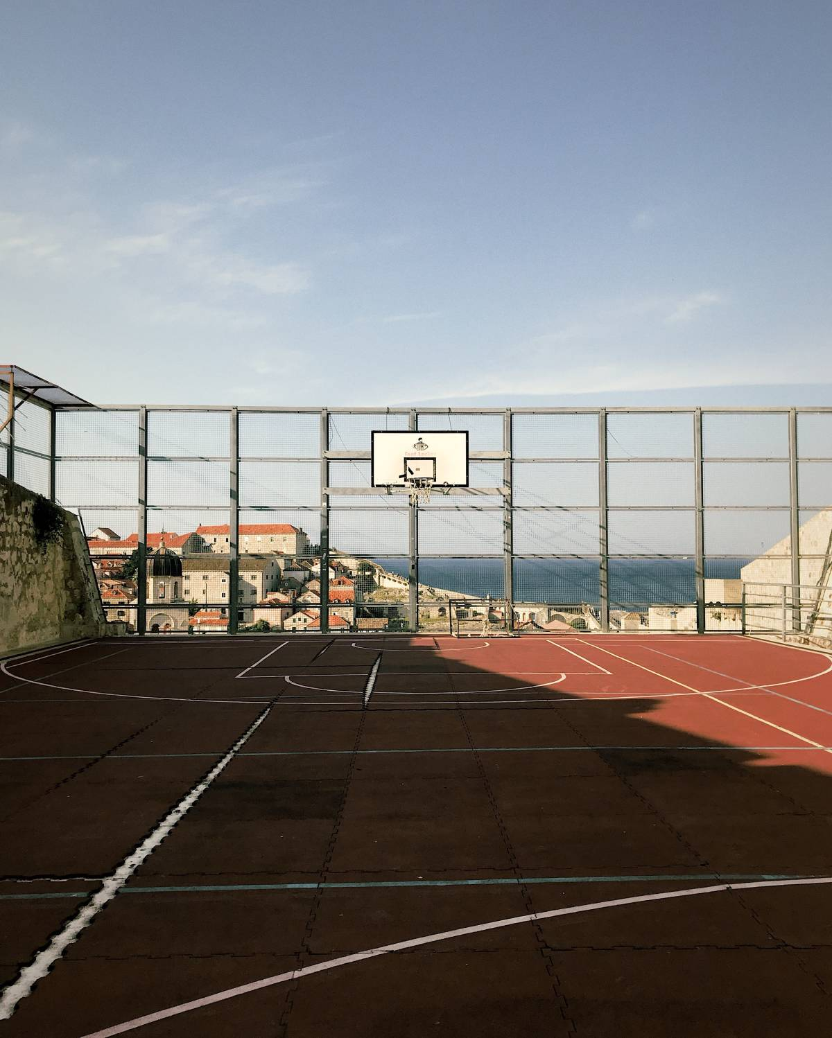 An empty basketball court during the early morning light in Dubrovnik, Croatia.