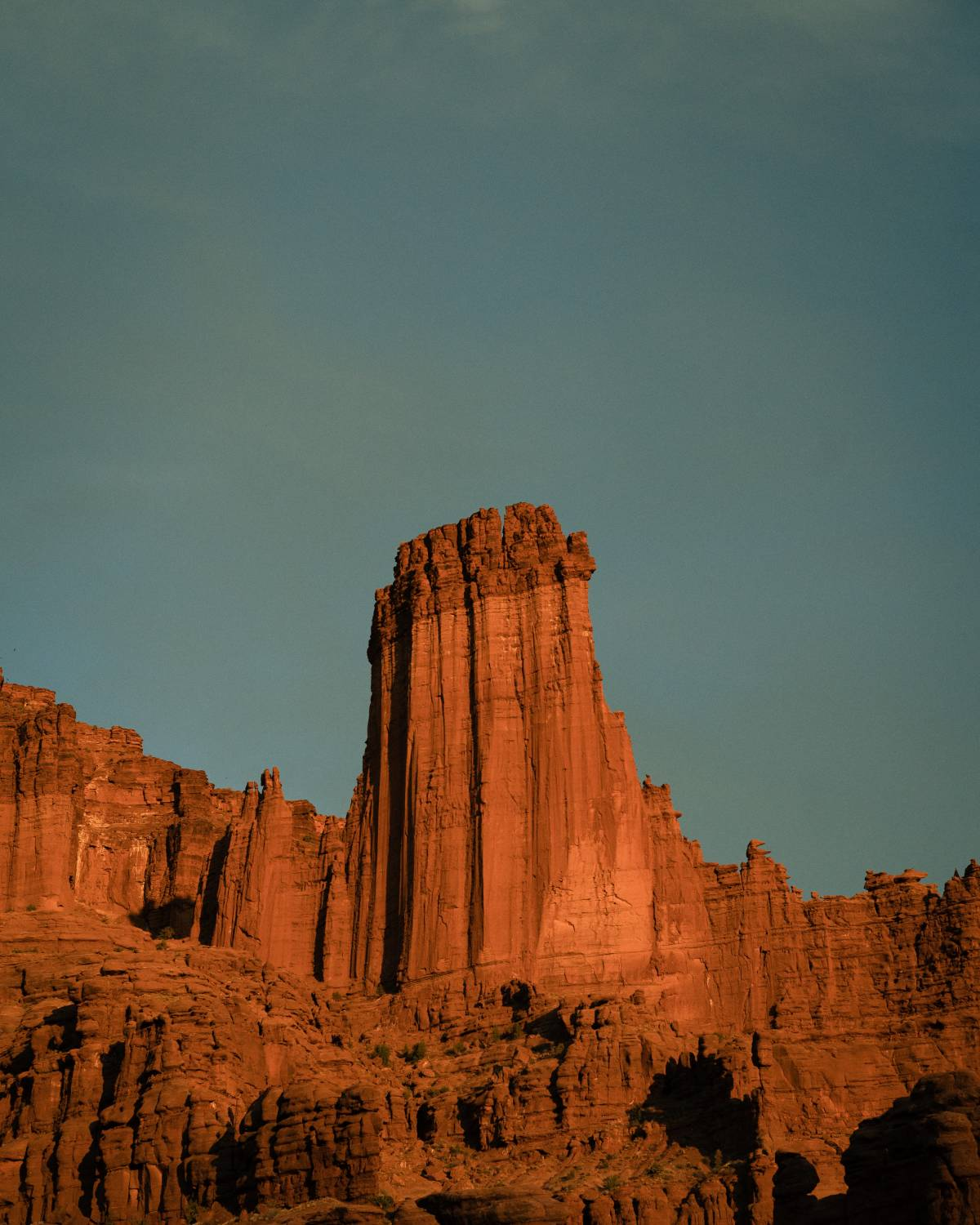A view of part of Fisher Towers at sunset.