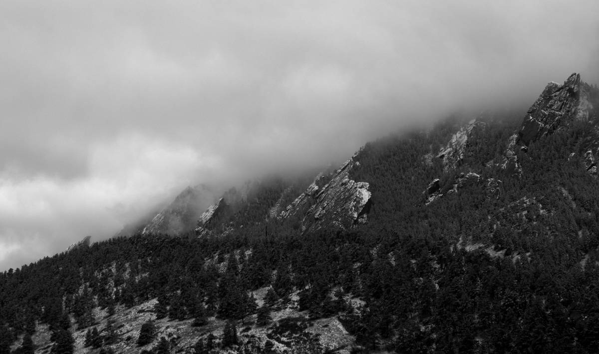 The Flatirons in Boulder after some fresh snow in the early morning