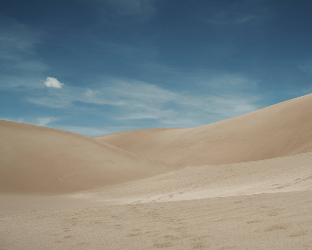 A look at sand dunes against the blue Colorado sky