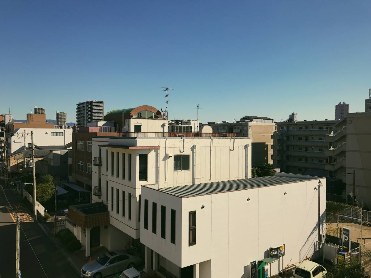 A view from a balcony looking out into Osaka early in the morning.