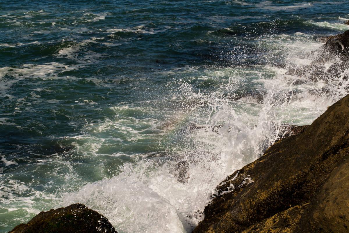 Waves crashing into shore in Oregon