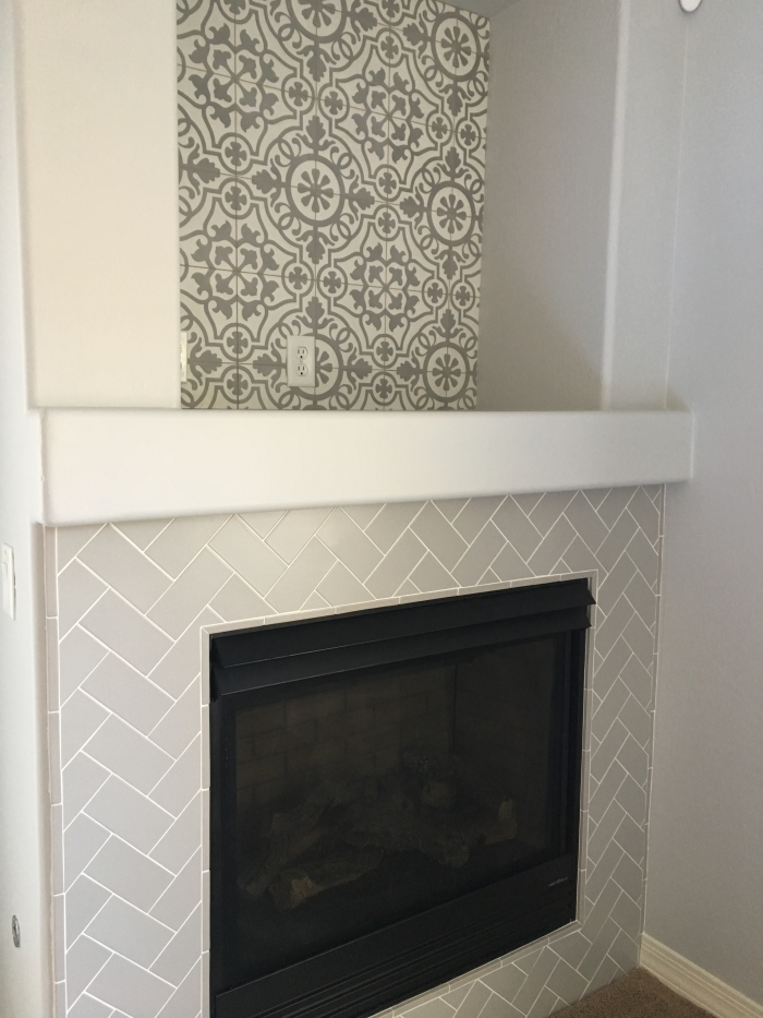 Remy 8x8 cement tile in Damsel and Costa Allegra 3x6 ceramic tile in Cinder on fireplace