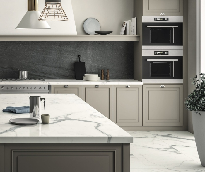 Magnifica Porcelain in Basalto on backsplash | Magnifica Porcelain polished Statuario Super White on countertop and island