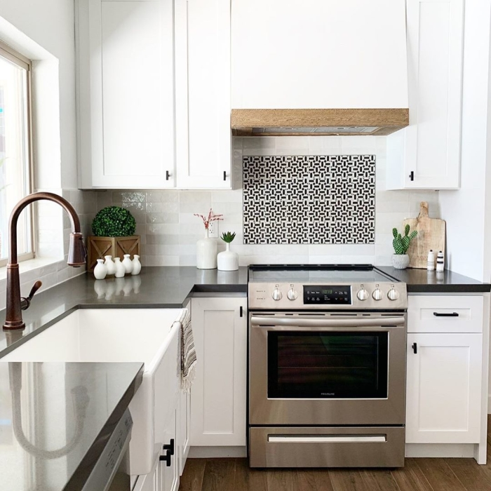 Design a graphic backsplash for visual effect in your white kitchen