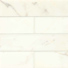Calacatta Oro honed 3x12 marble tile