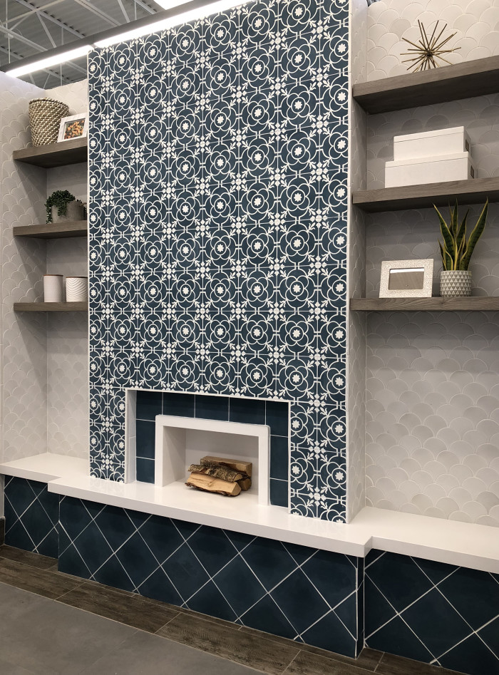 Main wall: Remy 8x8 cement tile in Brigette | Bookshelf walls: Paseo terra cotta tile Conche shape in Sierra White | Fireplace Bench: Sequel Quartz 2cm polished slab in Arlington White | Fireplace Bench Face: Remy 8x8 cement tile in Cobalt | Floor: River Wood 8x24 wood-look tile in Walnut