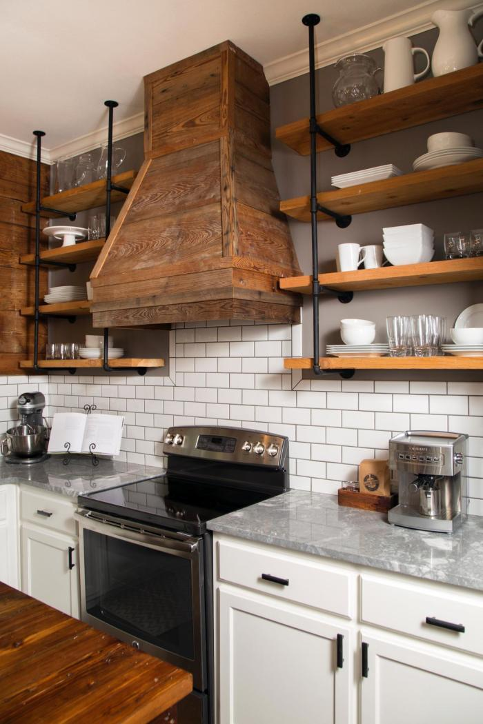 Subway tile wall with open shelving and steel pipe supports