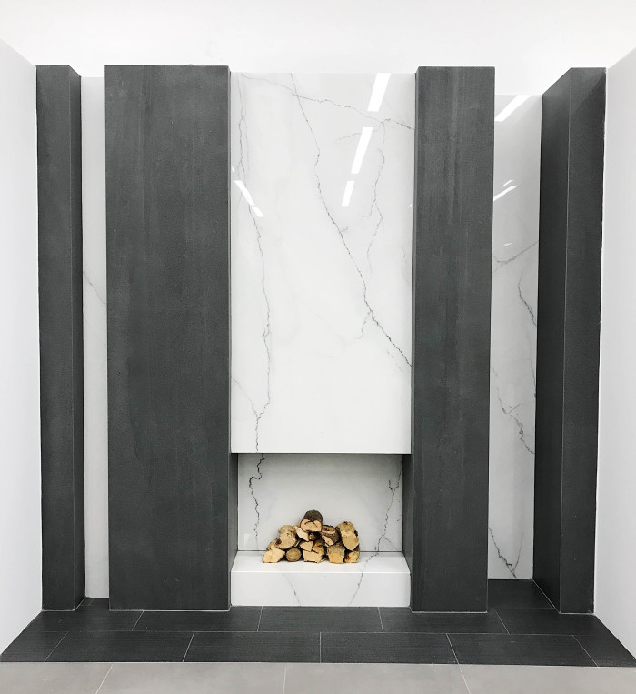 Fireplace inset: Magnifica® Porcelain in Lincoln Super White | Fireplace columns: Magnifica® Porcelain in Basalto | Floor: Stands 12x24 porcelain in Black