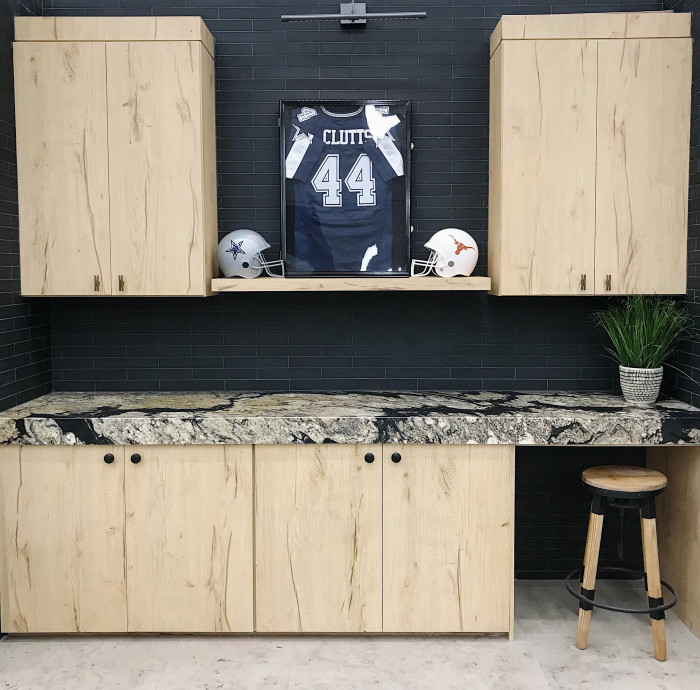 Backsplash: Verve 2x12 glass mosaic in After Dark matte | Countertop: Wild Fire 2cm polished granite slab | Floor: Jura Grey 18x18 honed limestone