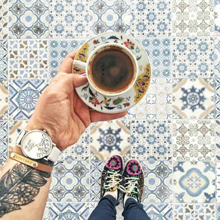 So many things here - that teacup, those shoes, the watch and tattoo, oh, an the tile.