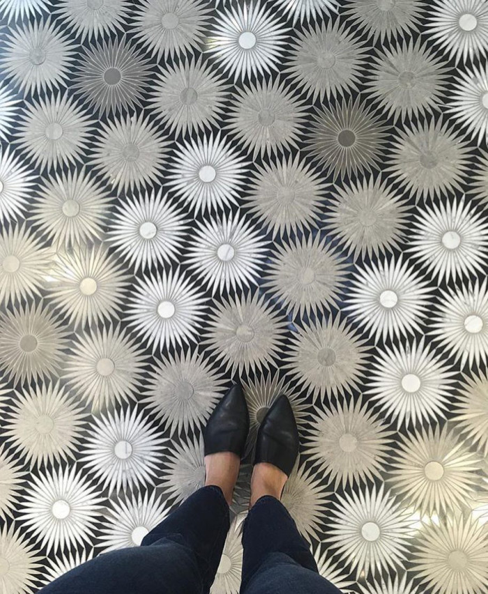 An incredible mosaic floor featuring Artistic Tile