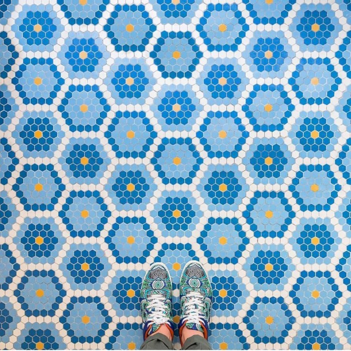 Contrasting blue and orange in the tile and shoes!