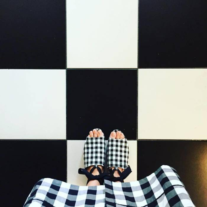 Checkered black and white shoes, dress, tile, oh my!