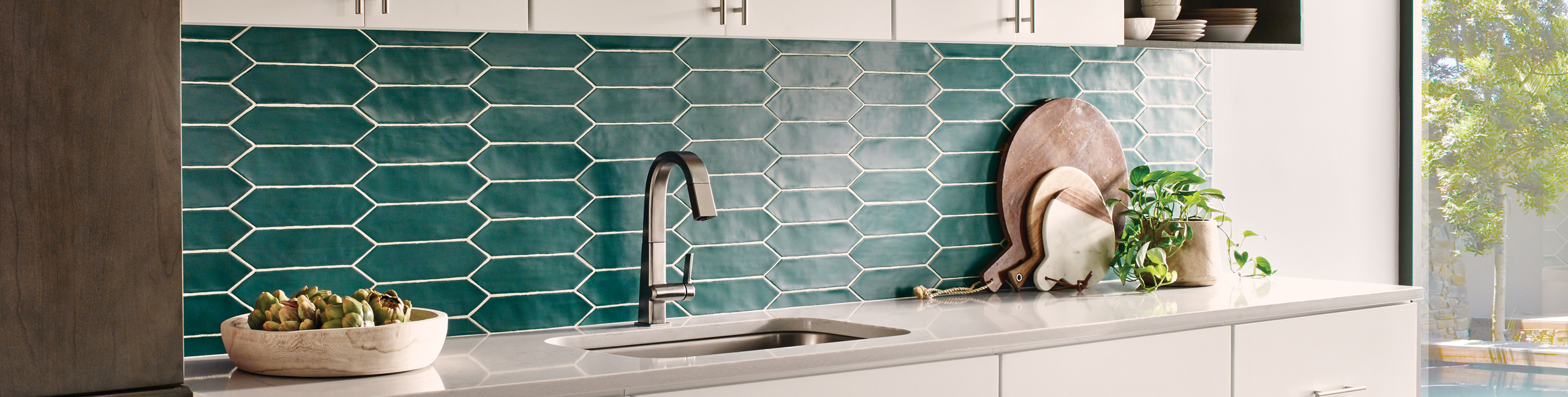 Bedrosians Reine picket style ceramic tile backsplash in Teal